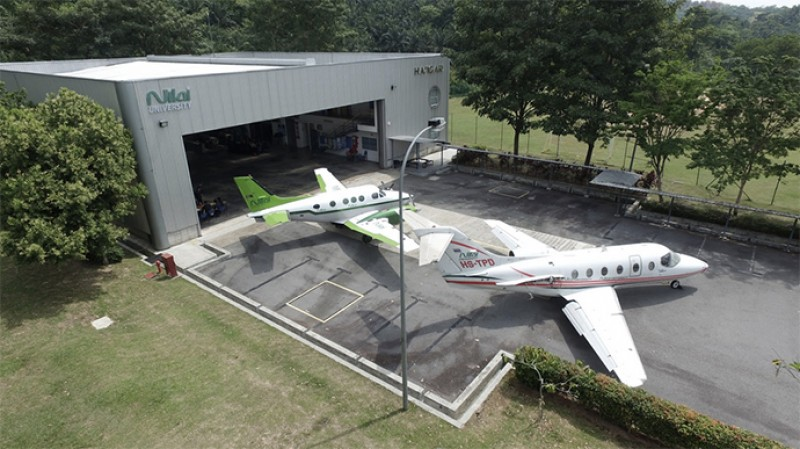 An aircraft hangar with 2 planes is dedicated for aircraft maintenance engineering students.