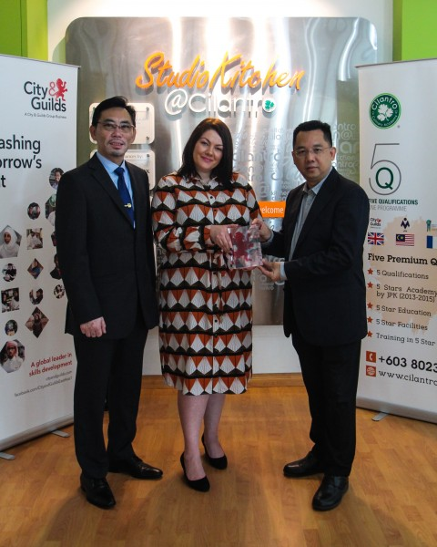 City & Guilds' head of international sales operation Ayesha Rees (middle) presents 'The International Centre of Excellence - Asia Pacific' award to Cilantro's training director Bernard Lee Then Kit (right) and executive pastry chef Chern Chee Hoong (left).