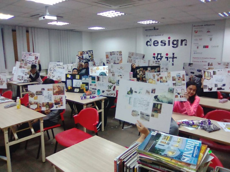 Students showcasing their assignments in a class
